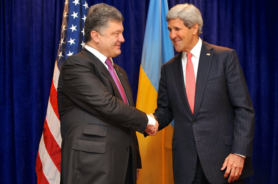 Secretary Kerry Shakes Hands With Ukrainian President-elect Poroshenko Before Meeting in Warsaw