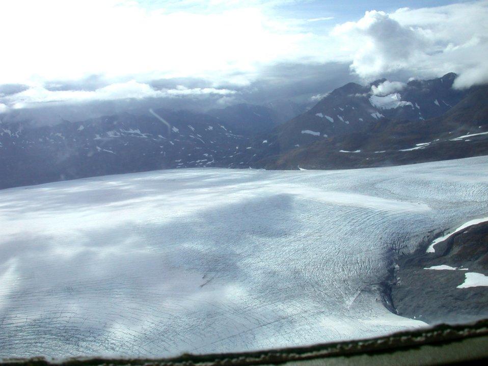 Float plane sightseeing along the Richardson Highway. Note cracks in glacier.