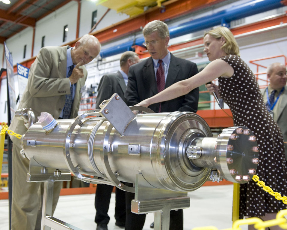 Fermilab scientist Camille Ginsburg explains the benefits of superconducting particle acceleration devices to DOE Office of Science Director Bill Brinkman (left) and Deputy Secretary Poneman.