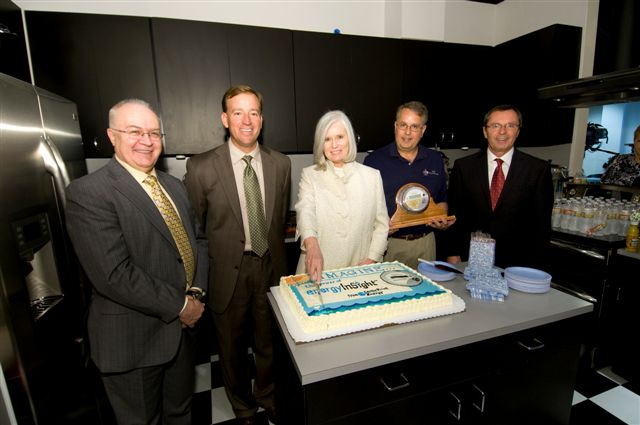 Ruth D'Iorio cutting million meter cake with Don Macdonald, Kenny Mercado, Craig Funni and Malcolm Unsworth