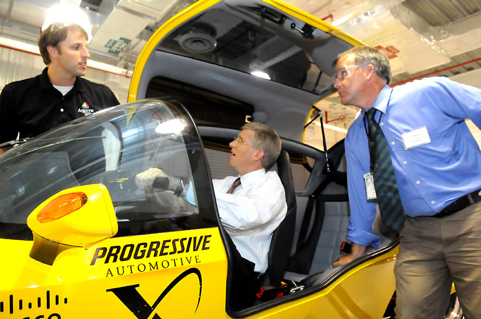 Deputy Secretary Poneman tries out a finalist for the Progressive Automotive X prize
