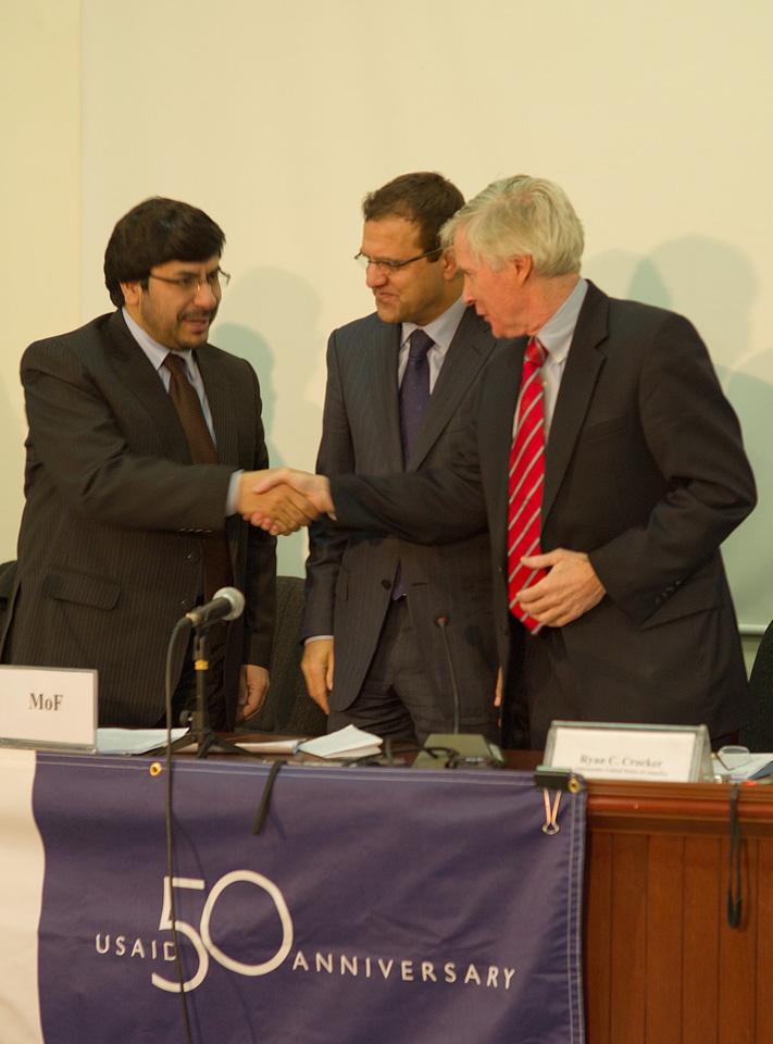 Ambassador Crocker shaking hands