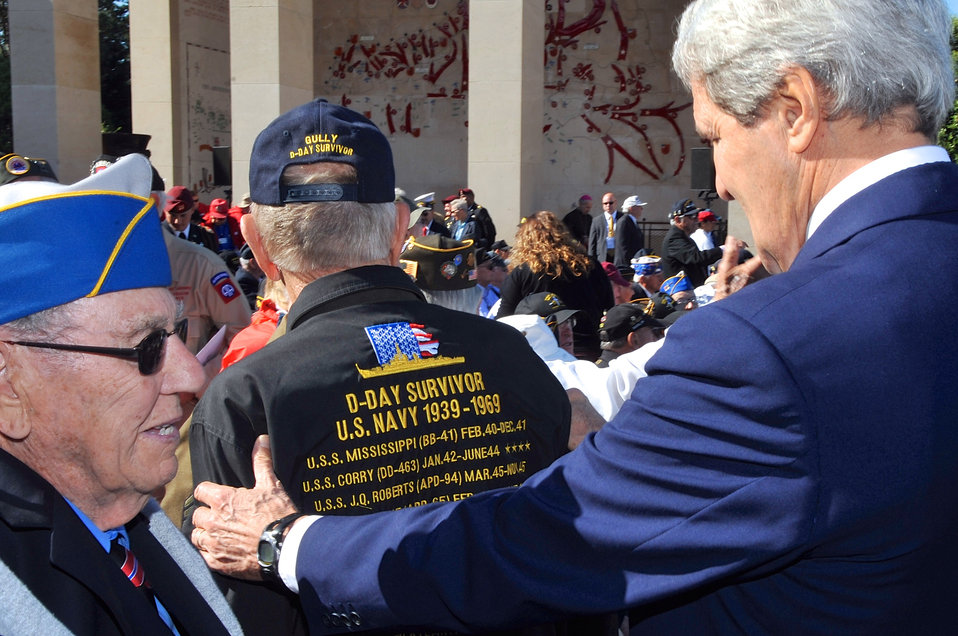 D-Day Veteran Shows Secretary Kerry a Jacket Outlining Military Career