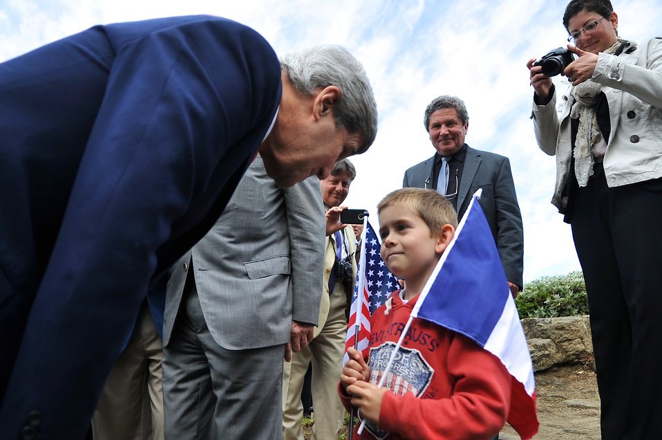 Secretary Kerry Greets a Young Resident of Saint Briac, France
