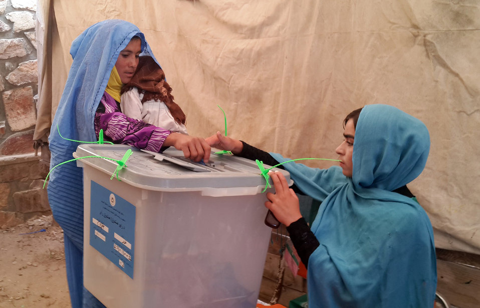 A woman casts her ballot in Ghor province.