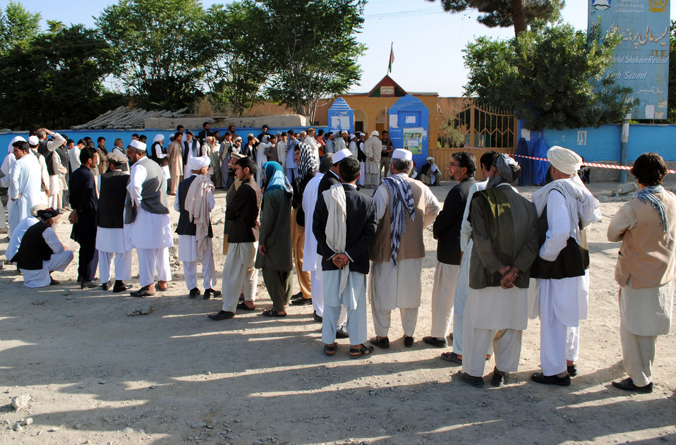 Voters line up in front of a polling station in Bagrami district of Kabul province.