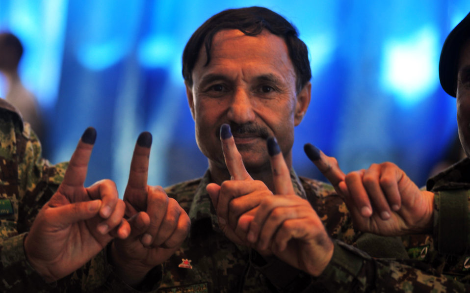 Afghan National Army (ANA) officers show colored fingers after casting ballots in Kabul.