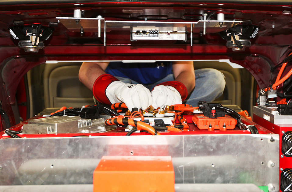A team member from North Carolina State University prepares for high voltage testing on their battery pack during the Year 2 competition. Th