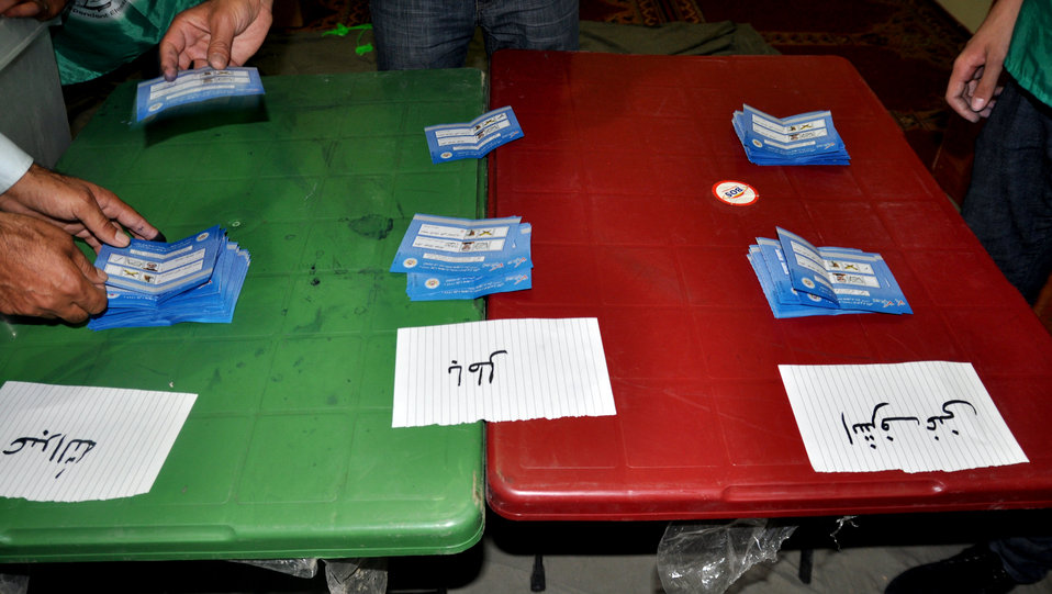 IEC workers count ballots in Kabul.