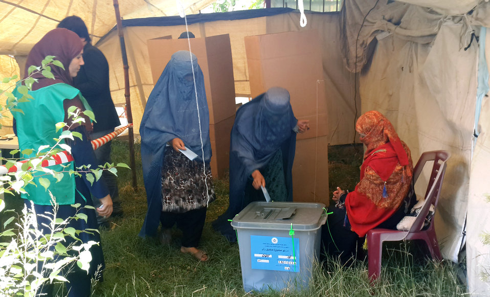 Women voters cast their votes at a polling center in northern Takhar province.