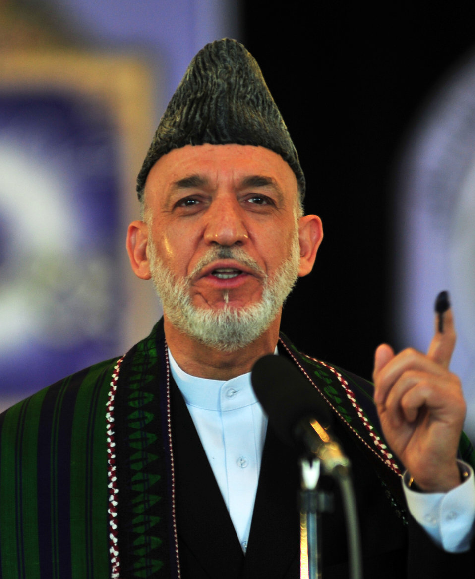 "President Hamid Karzai speaks to the journalists in Kabul after casting his vote. He said Afghans should vote for the candidate of their choice and called the vote ""a step towards progress and democracy."""