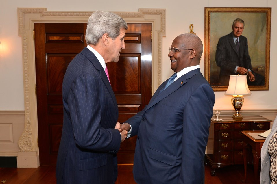 Secretary Kerry Shakes Hands With Ugandan Foreign Minister Kutesa