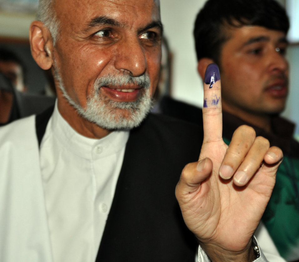 Dr. Ashraf Ghani Ahmadzai, presidential candidate, displays an inked finger after casting his vote in Kabul shows his inked finger.