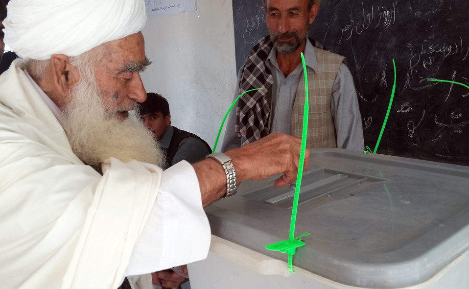 An elderly casts his vote for his favorite presidential candidate in central Parwan province.
