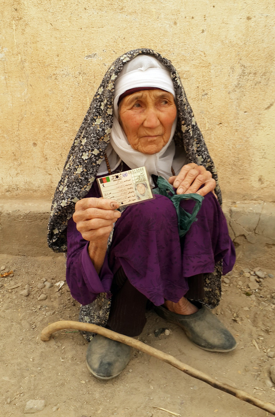 An elderly woman posing for a photo after casting her vote in Badghis province.