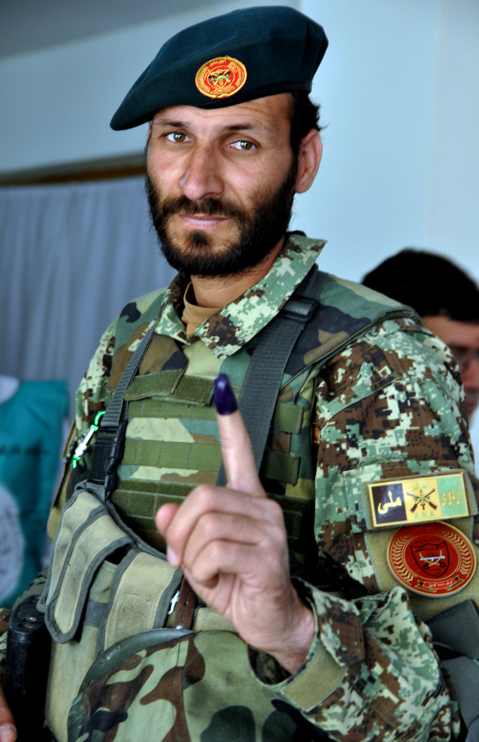 An Afghan National Army (ANA) officer shows his inked finger at a polling center in Kabul.