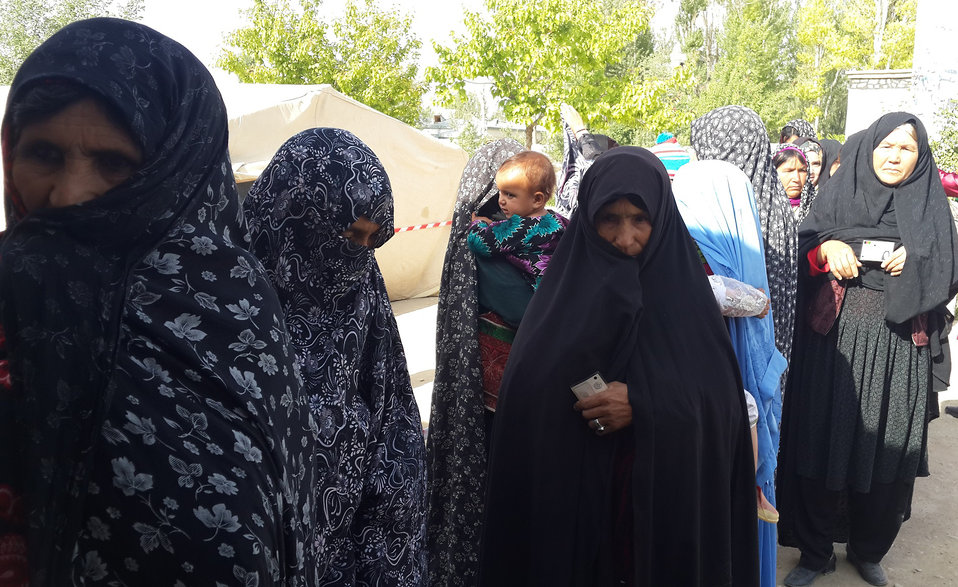 Women in front of a voting center in Ghor province.