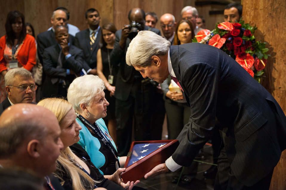 Secretary Kerry Presents Rebecca Bynum a Flag in Honor of Her Son, Kevin Bynum