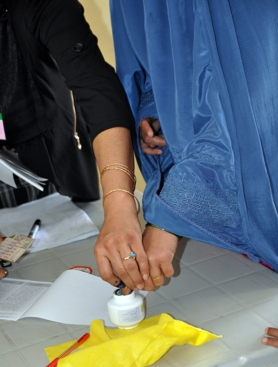 A woman inks her finger at a polling center in Kabul.