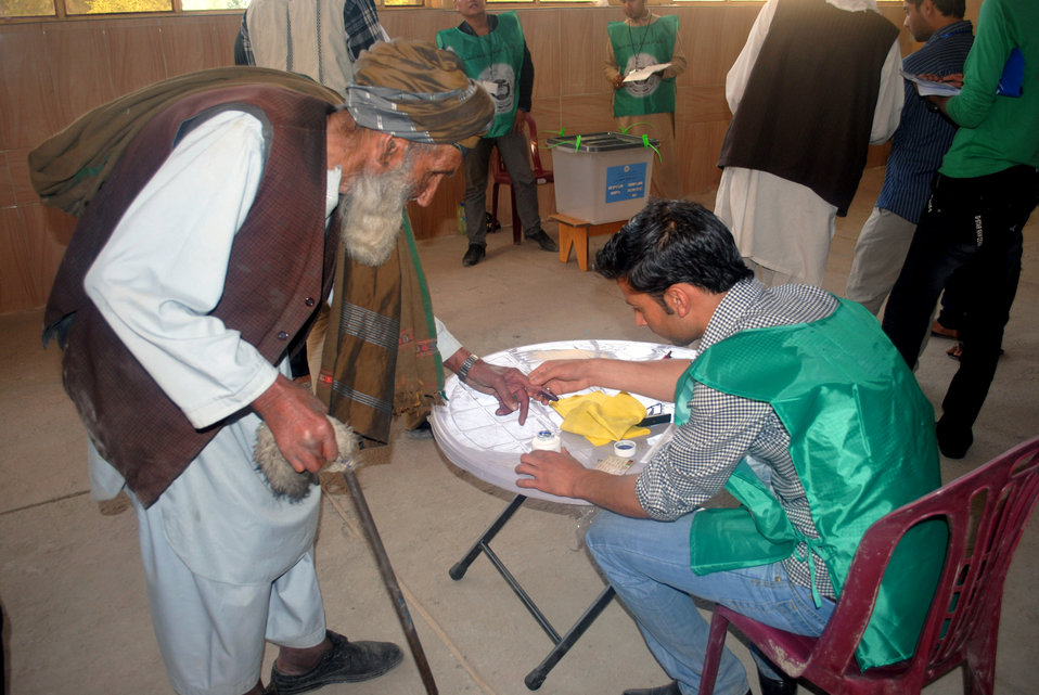 An elderly man casts his vote in a voting center in ninth police district in Kabul.