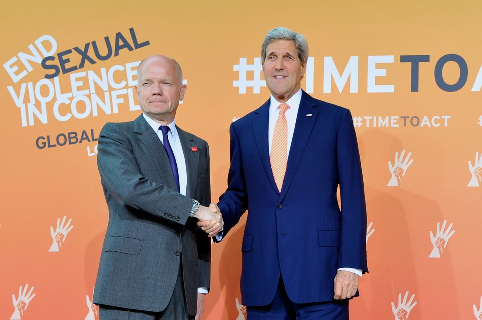 British Foreign Secretary Hague, Secretary Kerry Pose for Photographers at Global Summit to End Sexual Violence in Conflict