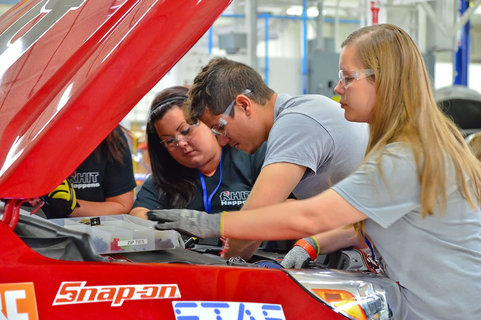 Students from Rose-Hulman Institute of Technology work under the hood of their car at the Year 2 finals in Yuma, Arizona. Rose-Hulman Instit