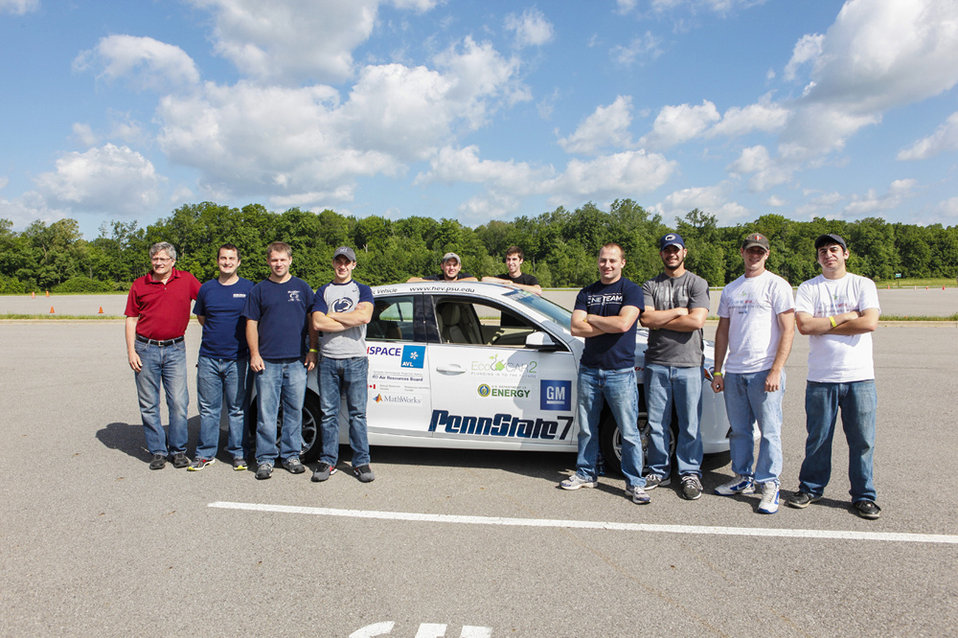 The team from Penn State University placed third with their E85 series plug-in hybrid. Pictured here members of the team poise with their ca
