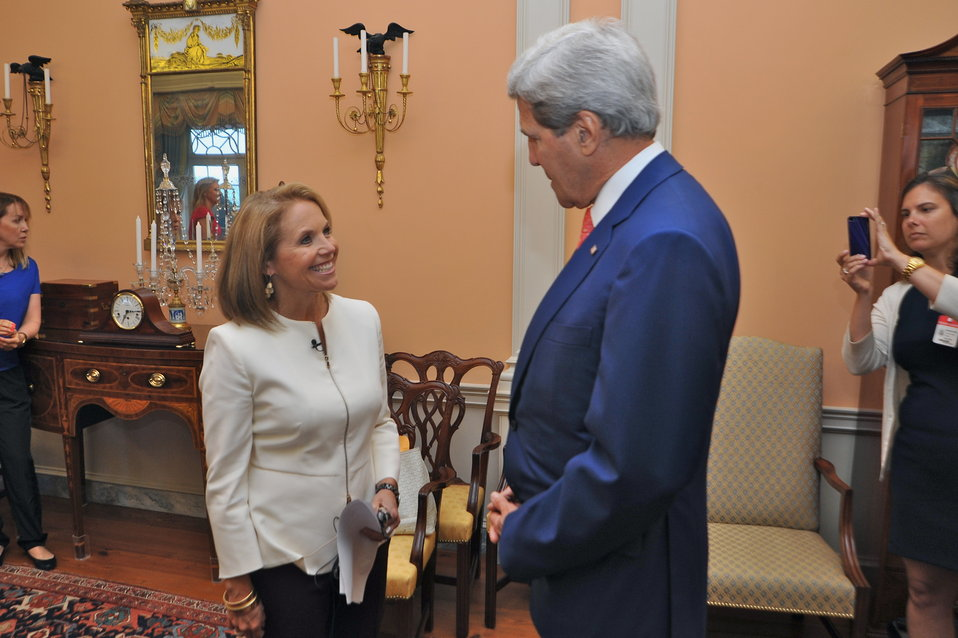Yahoo! News Reporter Katie Couric Greets Secretary Kerry