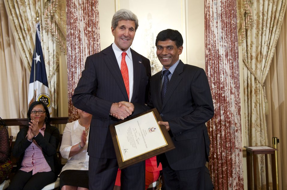 Secretary Kerry With TIP Hero Tek Narayan Kunwar of Nepal