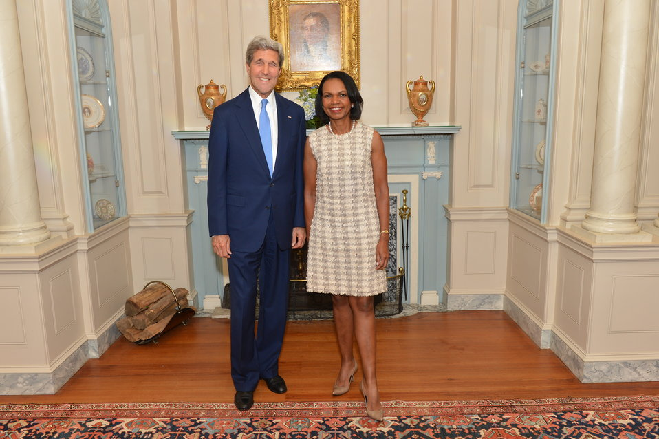 Secretary Kerry and Former Secretary of State Condoleezza Rice Pose for a Photo at a Portrait Unveiling Ceremony in Honor of the Former Secretary