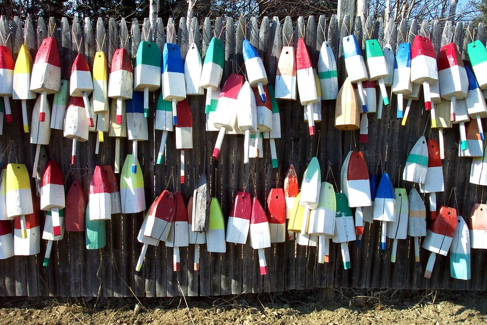 Floats for lobster traps adorning a Maine fence.