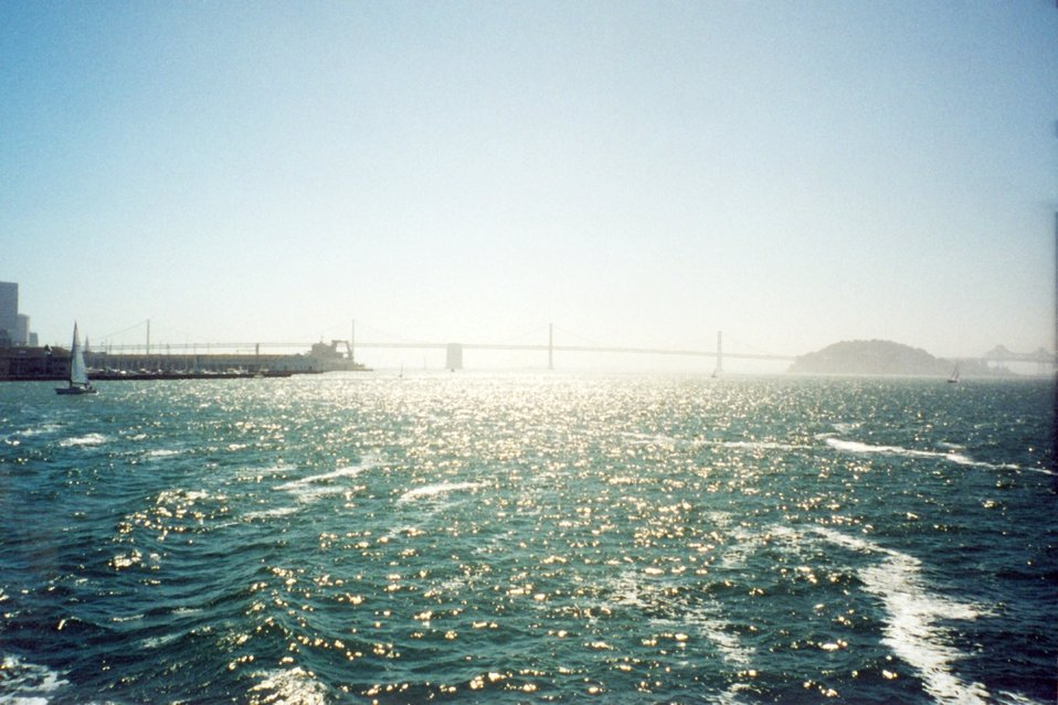Looking down the bay towards the San Francisco - Oakland Bay Bridge on a hazy afternoon.