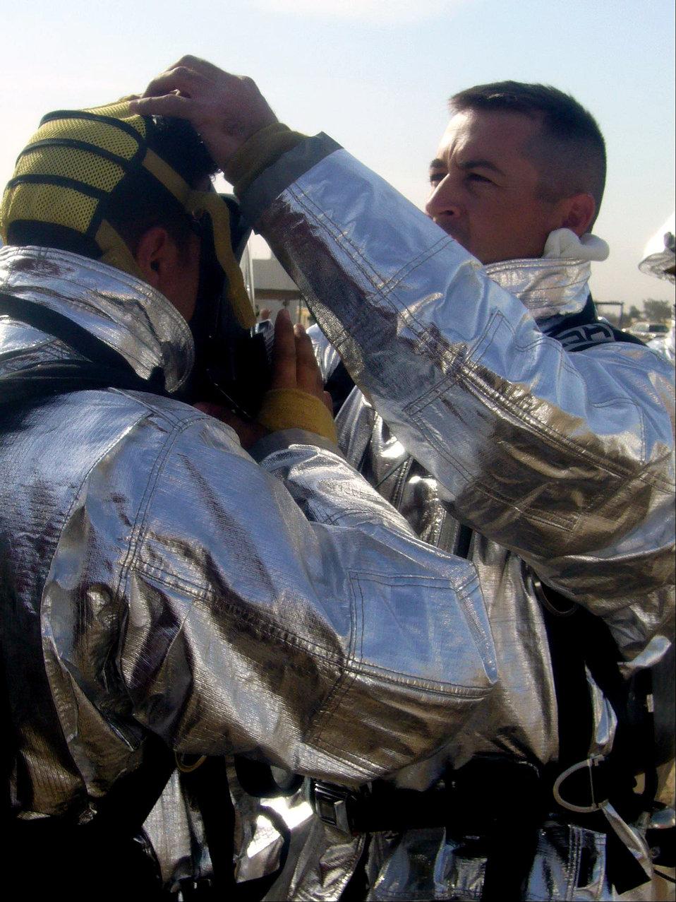 Iraqi Air Force Training School graduates firefighters, officers