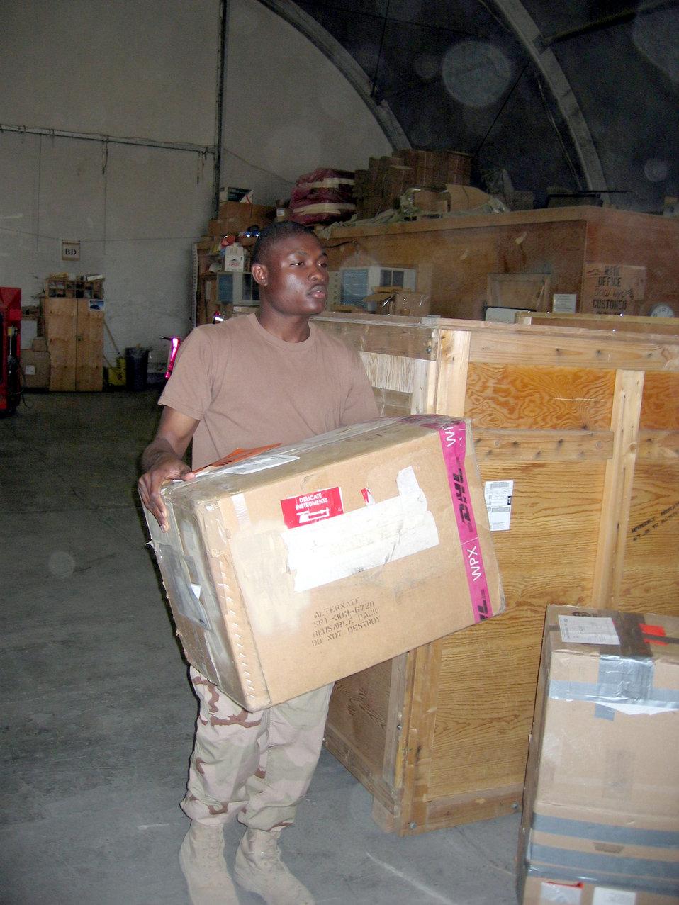 Supply Airmen keep deployed essentials on shelf