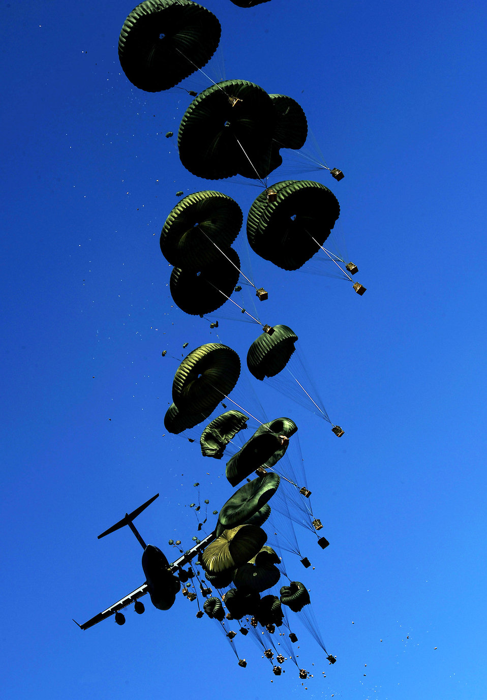 Airmen airdrop relief supplies to Haitians