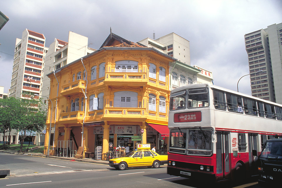 This 1995 photograph depicted a typical street corner in Singapore with older colonial-style buildings in the foreground, and some recently-