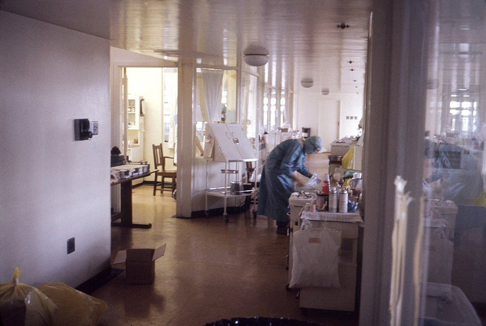 This photograph shows a nurse in an isolation ward during the 1975 Marburg outbreak in Johannesburg, South Africa.