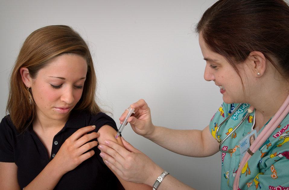 Nurse and immunization patient