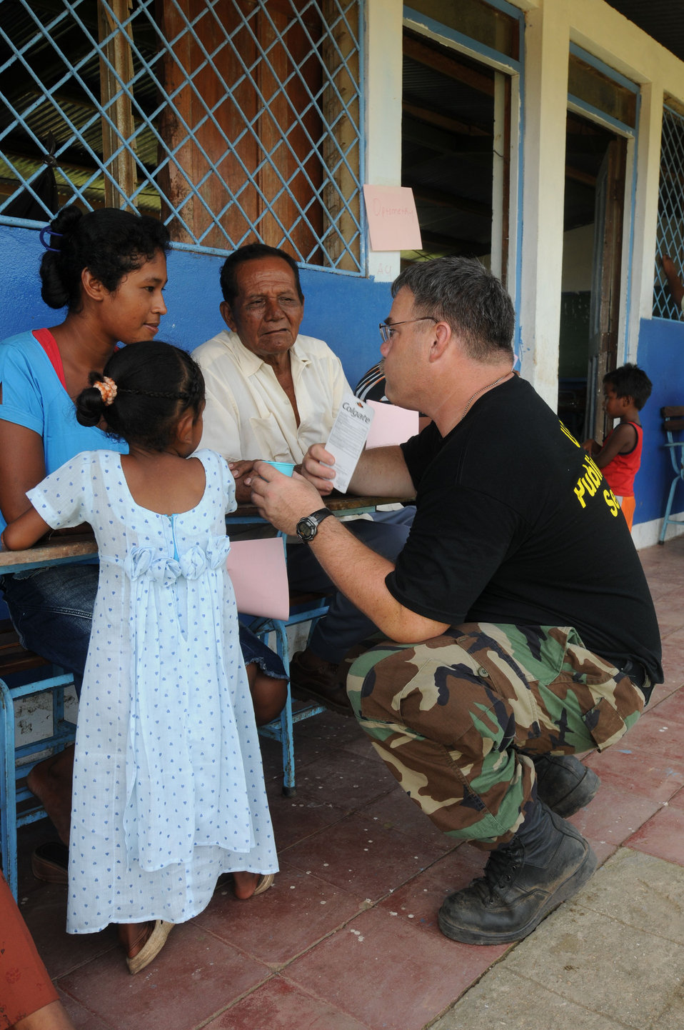 This 2008 photograph depicts U.S. Public Health Service (USPHS), Cmdr. Dale Bates, talking to a female patient in Puerto Cabezas, Nicaragua,
