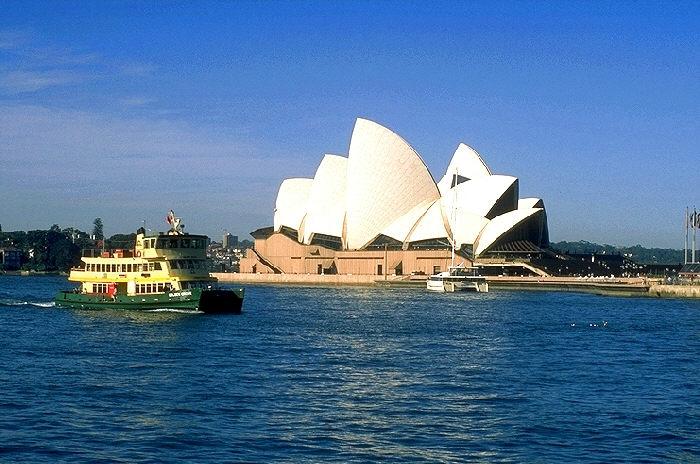 Opera House and ferry boat, Sydney, Australia.