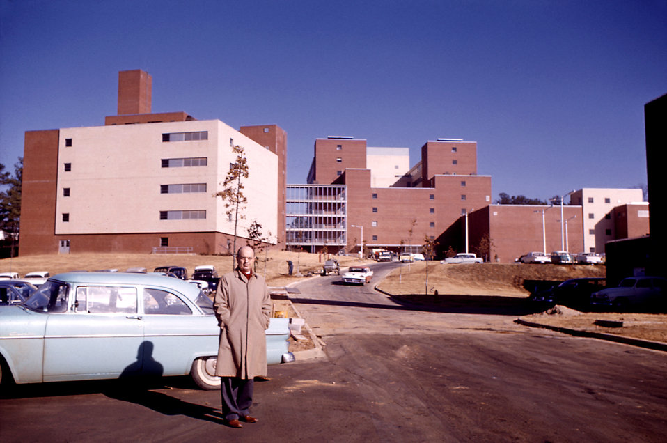 This 1961 photograph shows Dr. Alex Langmuir standing before CDC buildings at the Clifton Road, Atlanta, Georgia location.