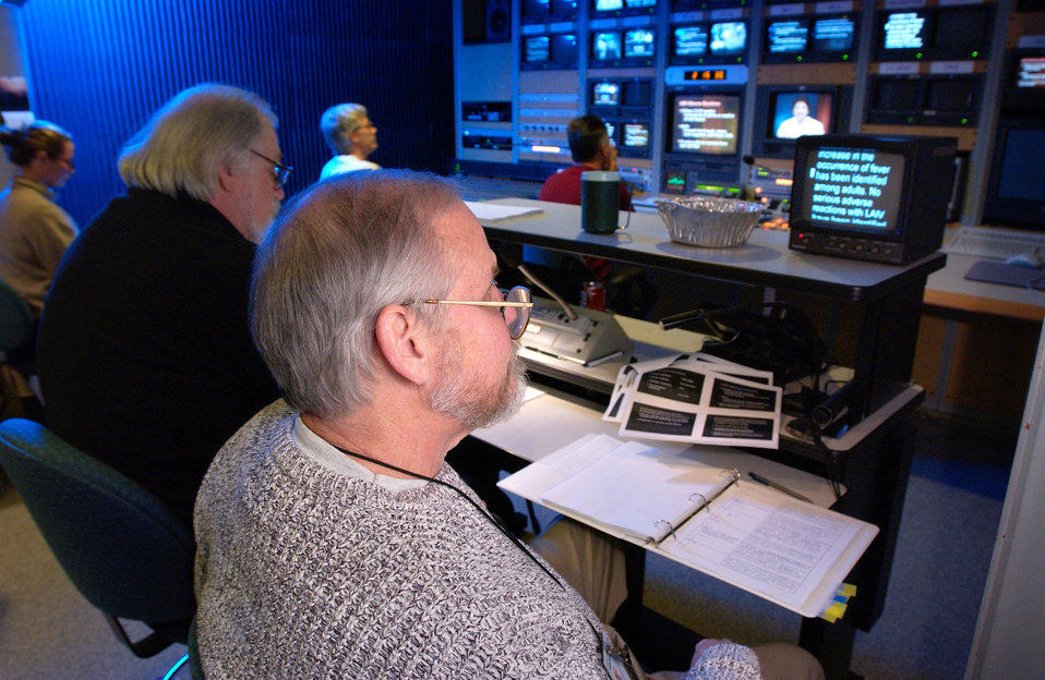This photograph showed Division of Creative Services (DCS), Editor/Director Ron Bartlett (left), and Audio Visual Production Specialist Larr