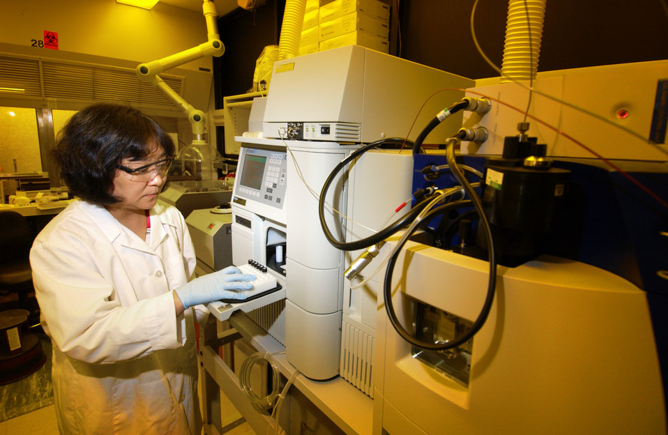 This 2004 photograph showed CDC research biologist Hui Ping Chen, preparing a High Performance Liquid Chromatography (HPLC) instrument in or