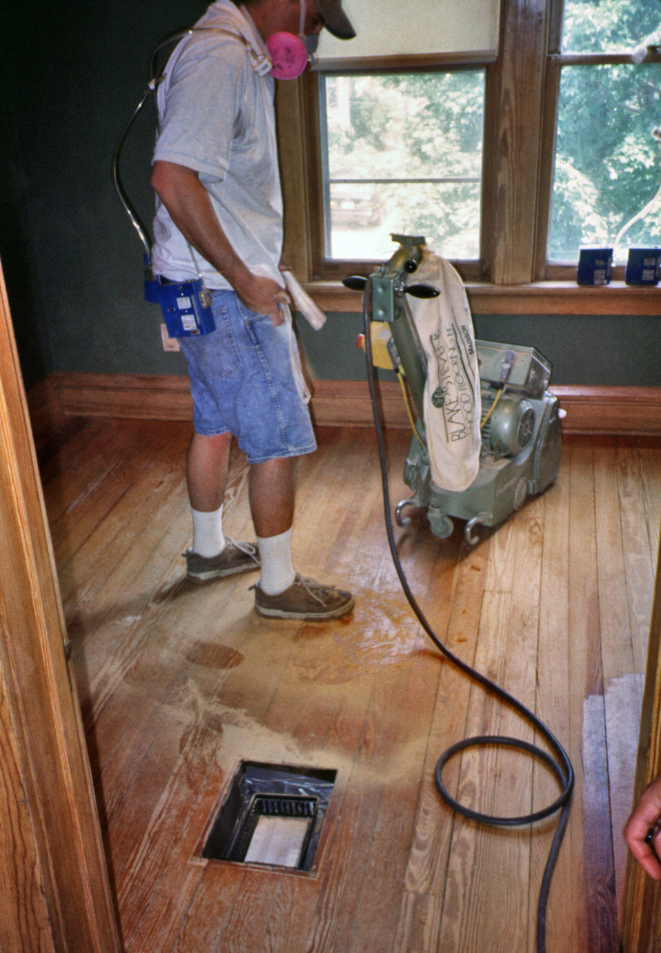 This 2000 photograph depicted a worker as he rough sanded a hardwood floor in a home in Madison, WI in preparation of refinishing its lead-b