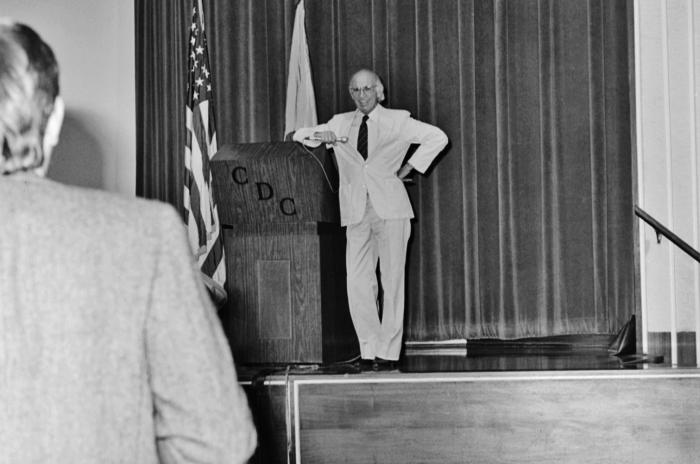 Standing at the podium during his 1988 Centers for Disease Control visit, this photograph showed Dr. Jonas Salk, creator of the first polio
