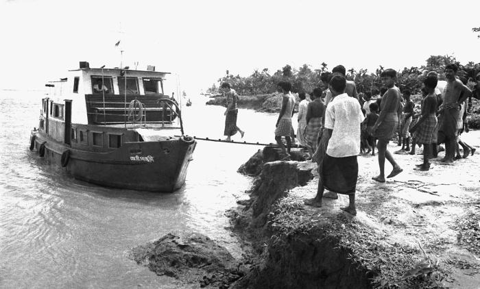 This image showed a converted Red Cross x-ray boat used to transport E.I.S. officers, and local public health personnel. 'In the towns of Ba