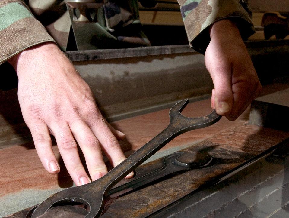 Technicians cut metal waste