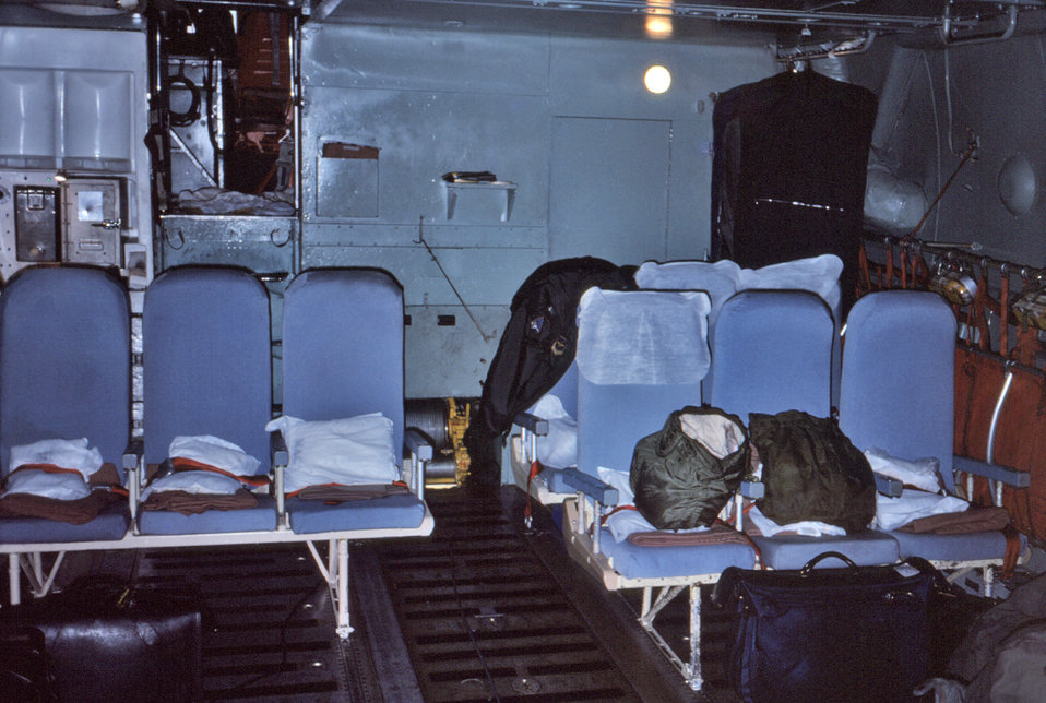 This 1976 photograph revealed the seating configuration inside the belly region of the C-141 jet aircraft, used to transport the CDC's mobil