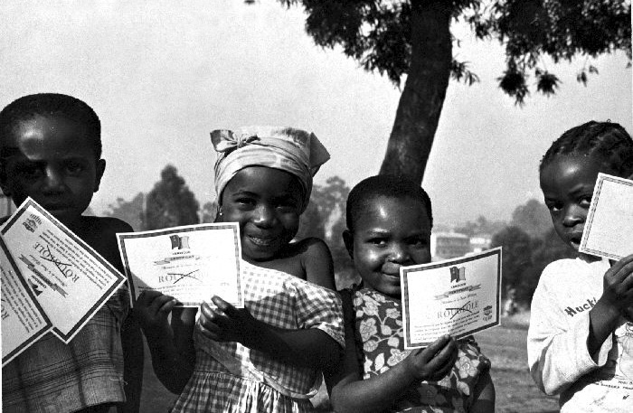 Children of Cameroon with their  vaccination certificates after having been vaccinated against smallpox.