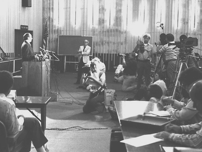 CDC Director, Dr. David Sencer, is addressing media personnel, 1976.
